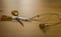 Scissors cutting headphones cord Royalty Free Stock Photo