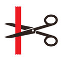 Scissors cutting a red ribbon isolated on white background Royalty Free Stock Photography
