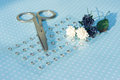Scissors, paper flowers and rhinestones are on paper with polka Royalty Free Stock Photo
