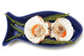 Scollops in a fish shaped bowl Stock Photos