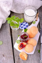 Scone with strawberry jam, afternoon tea , Royalty Free Stock Photo