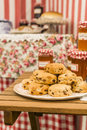 Scones and jam jars a pile of with raisins in the background Stock Image