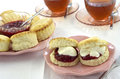 Scones with plum preserve and clotted cream Stock Photo
