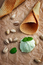Scoop of pistachio ice cream and waffle cone Royalty Free Stock Photo