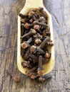 Scoopful of cloves Royalty Free Stock Images