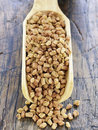 Scoopful of fenugreek Royalty Free Stock Images