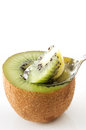 Scooping kiwi fruits with spoon on white background Stock Image