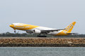 Scoot airlines boeing jet taking off airliner amid reports the airline will move to a fleet of aircraft by the end of photo Stock Photo
