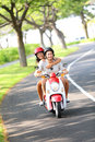 Scooter - couple driving in summer Stock Image