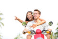 Scooter couple lifestyle fun driving in summer having on vacation holidays young happy interracial Royalty Free Stock Photos
