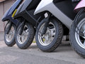 Scooter wheels in a row Stock Photos