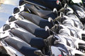 Scooters white in a row Stock Images