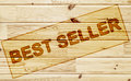 Scorched tag best seller on the wooden surface Royalty Free Stock Photography