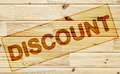 Scorched tag discount on the wooden surface Stock Photography