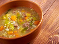 Scotch broth soup farmhouse kitchen old fashioned thrifty made from meat on the bon Royalty Free Stock Photo