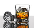 Scotch and decanter top glass of on the rocks with stopper reflections vertical composition with copy space over white background Royalty Free Stock Image