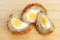 Scotch egg cut on a wooden board Stock Photos