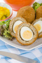 Scotch egg hard boiled wrapped in sausage meat coated in breadcrumbs and deep fried served with salad and piccalilli Royalty Free Stock Photo