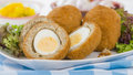 Scotch egg hard boiled wrapped in sausage meat coated in breadcrumbs and deep fried served with salad and piccalilli Royalty Free Stock Photography