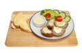 Scotch egg salad and with bread and butter on a wooden board isolated against white Stock Image