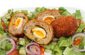 Scotch eggs closeup of freshly cooked with salad on a plate Stock Photography