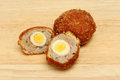 Scotch eggs freshly made on a wooden board Stock Photos