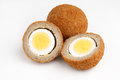 Scotch eggs a hard boiled egg wrapped in pork sausage meat and breadcrumbs studio Royalty Free Stock Image