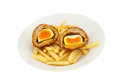 Scotch eggs runny yolk egg and chips in a bowl isolated against white Royalty Free Stock Photography