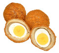 Scotch eggs traditional one cut in half showing the boiled egg inside isolated on a white background Royalty Free Stock Photo