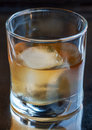 Scotch glass of delicious aged single malt on the rocks Stock Images