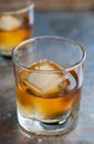 Scotch glass of delicious aged single malt on the rocks Royalty Free Stock Photography