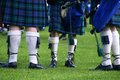 Scotish men legs special outfit of scottish wearing traditional kilts Royalty Free Stock Photo