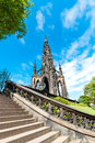 Scott monument in edinburgh the on s princes street with a curving stairway the foreground Royalty Free Stock Images
