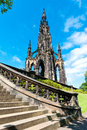 Scott monument in edinburgh the on s princes street with a curving stairway the foreground Royalty Free Stock Image