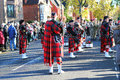 Scottish bagpipe band in kilts a pipe wearing traditional the is standing the street and preparing to play the bagpipes and drums Stock Image