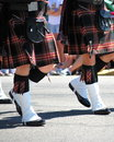 Scottish bagpipe marching band in a parade in scotland Stock Photography