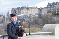Scottish bagpiper edinburgh scotland united kiingdom april unidentified playing music with bagpipe at edinburgh on april Stock Photo