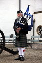 Scottish bagpiper playing unidentified music with bagpipe at edinburgh on june edinburgh is the most popular tourist destination Royalty Free Stock Images
