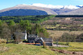 Scottish highlands scotland uk view to near spean bridge area green valley and traditional farm house on the foreground and green Stock Photos