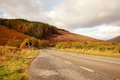 Scottish highway in Autumn, Scotland. Royalty Free Stock Images