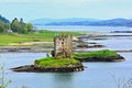 Scottish landscape with castle view of stalker surrounded by the lochs of scotland Stock Image
