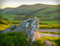 Scottish landscape at sunset a rolling with rock in foreground Stock Image