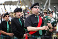 Scottish pipers in band a of playing a parade Royalty Free Stock Images
