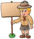 Scout boy holding wooden board Stock Images