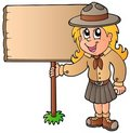 Scout girl holding wooden board Stock Images
