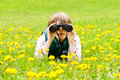 Scout young explorer in a dandelion field Royalty Free Stock Photography