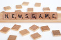 Scrabble tiles spell out 'Newsgame' Stock Image