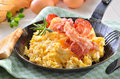 Scrambeld eggs fried bacon toast Stock Images