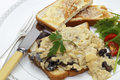 Scrambled egg with mushrooms meal a breakfast or light lunch of eggs on toast made fried and shallots served a sliced cherry Stock Photos