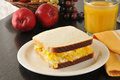 Scrambled egg sandwich a with fruit and orange juice Royalty Free Stock Photos